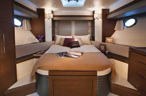 The forward stateroom features an island queen and lots of headroom.
