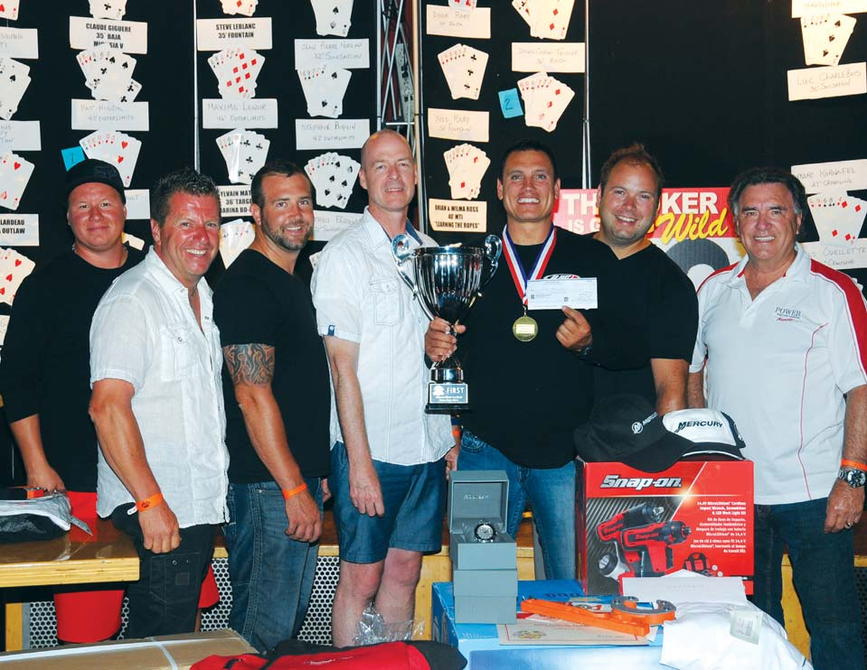FIRST PLACE: Patrick Higgins and Team Go Fast. Bill Taylor (far right) and Richard Allard of Golden Anchor Marina (second from left) presents owner Patrick Higgins (center) with the first place trophy.