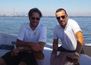 xecutive Yacht Partners Derek Mader and Ron Peruzza enjoying a day cruise with a client on Lake Ontario.