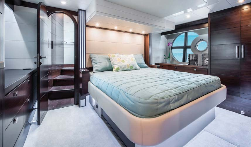 The master stateroom full beam layout is bright and open thanks to two large windows in either side of the hull.